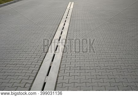 Drainage Element In Interlocking Paving Concrete Gutter With Slotted Drain From One Piece Of Concret