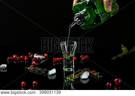 Alcohol, Luxurious Spirits And Dangerous Liquor Absinthe, Pouring, Green Bottle Of Strong Spirit.