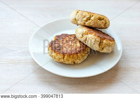 Homemade Cottage Cheese Pancakes Syrniki Stack On Plate On White Table Background. Close Up. Selecti