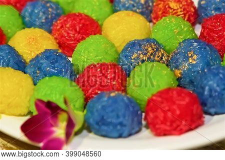 Colorful Sweet Rice Balls With Golden Powder, Christmas And New Year Food, Asian Rice For Vegans And