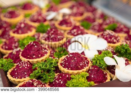 Traditional Russian Beet Salad In Waffle Baskets For New Year Decorated With Sesame Seeds, Parsley A