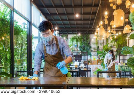 Portrait Attractive Asian Restaurant Employee Wear Face Mask And Face Shield Cleaning Table And Floo