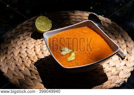 Indian Dal Soup With Fried Onions Garnished With Lime, Vegetarian And Vegan Dish, Balanced Meal, Pro