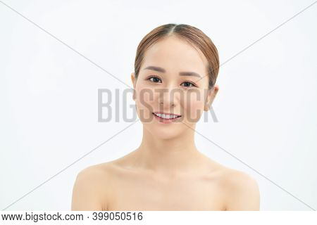 Portrait Of Young Asian Woman With Natural Skin On White Background.