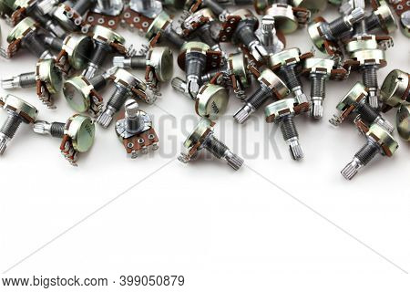 Many potentiometers. Heap of potentiometers, usually known as volume pot on white.