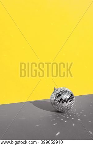 Disco Ball With Background In Trending Colors Of 2021 - Gray And Yellow. Trending Color Combinations