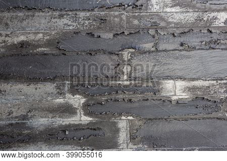 A Very Old Painted Brick Wall With Peeling Paint. Old Walls With Peeling Plaster. Retro Grunge Wall.