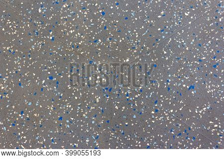 A Gray Surface With Colored Particles Arranged Randomly. Clusters Of Particles Arranged Randomly In