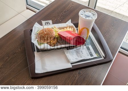 Prague, Czech Republic - July 10, 2020: Mcdonald Menu With Crispy Chicken Deluxe Sandwich, French Fr