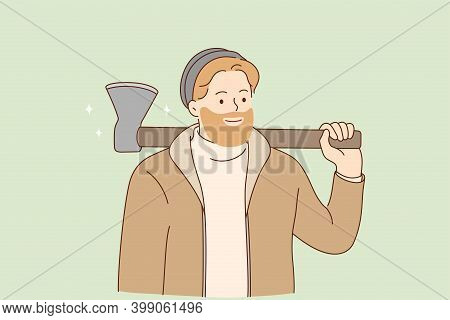 Brutal Lumberjack And Hipster With Beard Concept. Young Smiling Bearded Man In Warm Clothes Holding