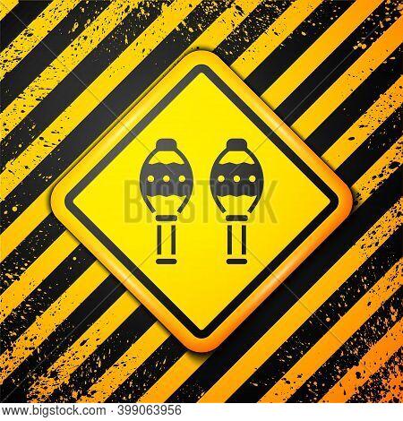 Black Maracas Icon Isolated On Yellow Background. Music Maracas Instrument Mexico. Warning Sign. Vec