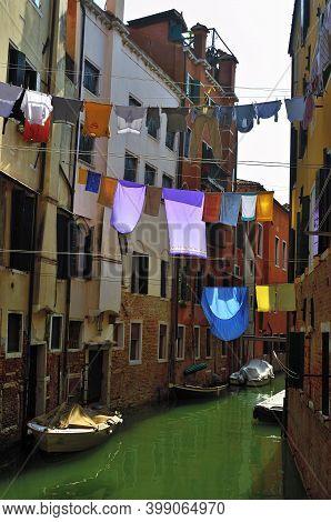 Venice, Italy - September 22, 2014:  Cannaregio, Ghetto Ebraico. Dried Dress Over Water Canal In Jew