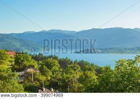 Landscape Of Lake Bicaz With Ceahlau Massif On The Background. Beautiful View Of Lakul Izvorul Munte
