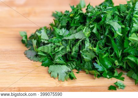 Chopped Parsley On A Wooden Chopping Board