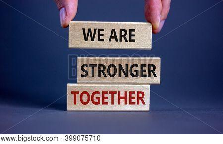 We Are Stronger Together Symbol. Wooden Blocks Form The Words 'we Are Stronger Together' On Grey Bac