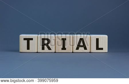 Trial Symbol. The Word 'trial' On Wooden Cubes On Beautiful Grey Background, Copy Space. Business An