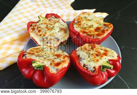 Closeup Of Plate Of Tasty And Healthy Homemade Stuffed Bell Peppers With Brown Rice
