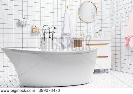 Interior Of Bathroom With Bathtub And Toiletries