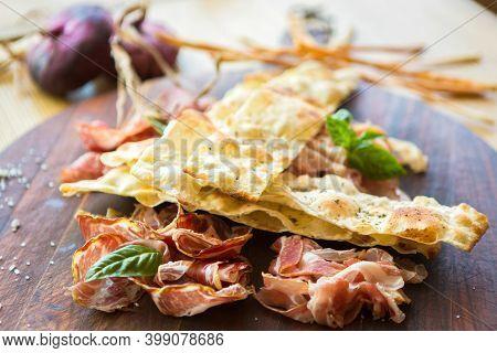 Prosciutto Ham And Grissini Bread Sticks. Italian Antipasto. Shallow Dof.