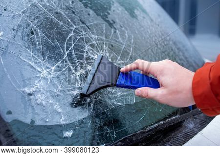 Ice Crusted On Car Windows. Driver Is Scraping Ice Off The Windshield. Freezing Rain, Anomalies Of N