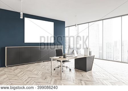 Mockup Canvas On Blue Wall In Minimalist Office With One Chair And Table With Computer, On Parquet F