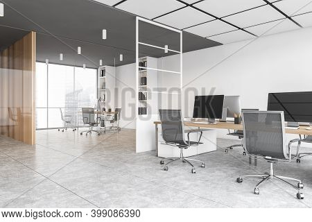 White Office Room With Armchairs And Computers On The Tables Near Windows, Side View. White Office C