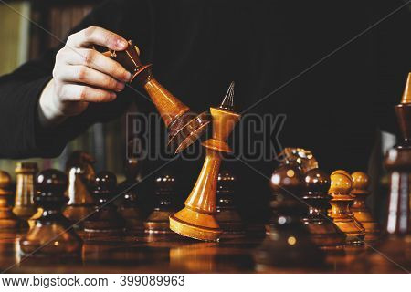 Game Of Chess. The Guy Makes A Move. Checkmate. Wooden Chess Pieces. Strategy Game