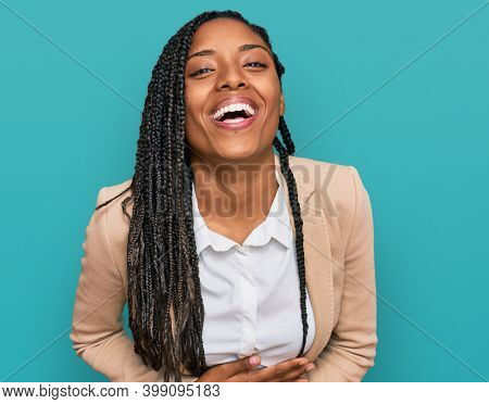 African american woman wearing business jacket smiling and laughing hard out loud because funny crazy joke with hands on body.