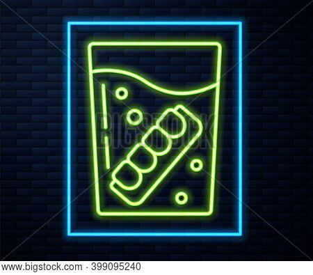 Glowing Neon Line False Jaw In Glass Icon Isolated On Brick Wall Background. Dental Jaw Or Dentures,