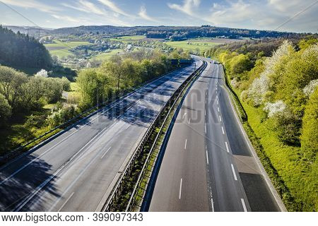 Autobahn Landscape In Germany In Summerwith Cloudy Sky