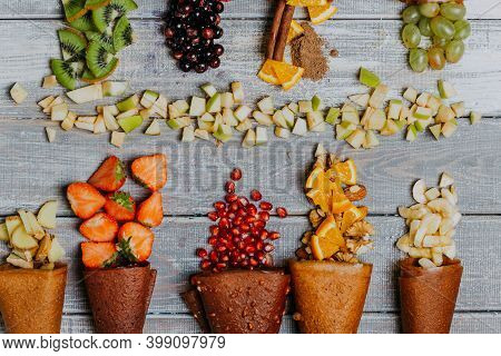 Fruit Leather Cones With Fresh Fruits In Pieces On The Wooden Table. No Sugar Fruit Leather Cones. H