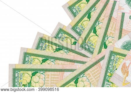 10 Sri Lankan Rupees Bills Lies In Different Order Isolated On White. Local Banking Or Money Making
