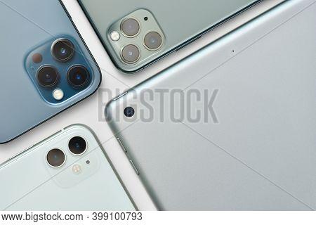 Stariy Oskol, Russia - December 10, 2020: Camera Lenses Of Modern Apple Smartphones Iphone 11 And 12