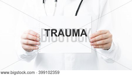 In The Notebook The Text Trauma, In The Hands Of The Doctor. Medical Concept. Treatment Of Stress, T