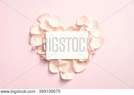 Heart Made Of Rose Petals And Blank Paper Card On Pink Background. Happy Valentines Day Or Mothers D