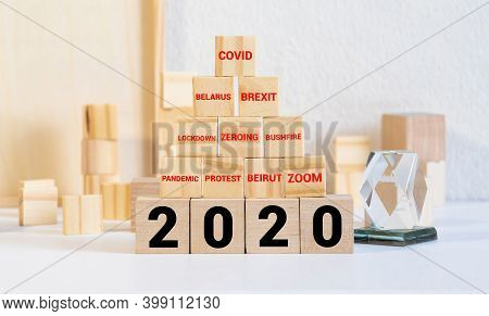 The Word Trends And 2020 New Year On Wooden Cube Blocks. 2020 Trends Concept. Main Trend Of Changing