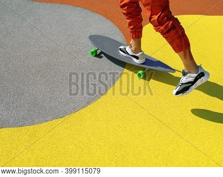 Unrecognisable Man Riding A Longboard On The Cityscape Background. Extreme Sport, Leisure Activity,