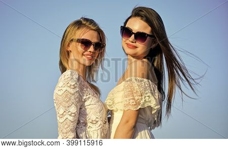 Beautiful Women On Sunny Day Blue Sky Background. Sisterhood And Female Community. Female Friendship