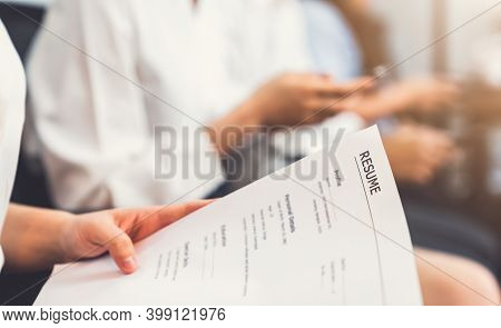 Hand Holding Document And Submit Resume To Employer To Review Job Application. The Concept Presents