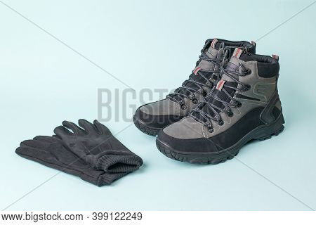 Mens Leather Gloves And Boots On A Blue Background. Mens Shoes For Cold Weather. Casual Sports Mens