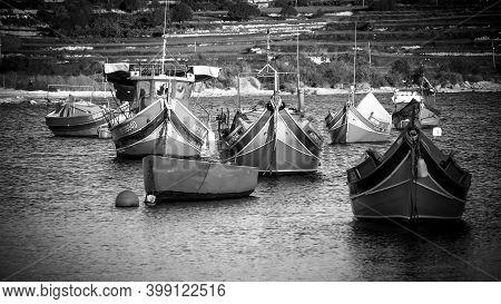 Colorful Fisher Boats In The Bay Of Marsaxlokk In Malta - Island Of Malta, Malta - March 5, 2020