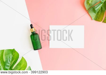 Top View On Green Bottle Cream And Post Note, Mockup Of Beauty Product Brand On The Pink Background.