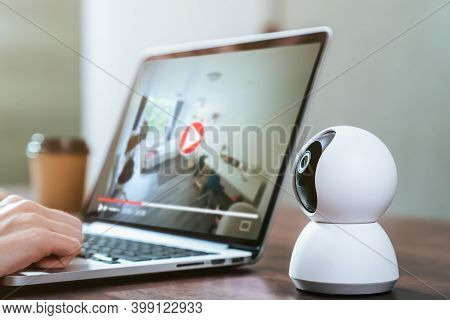 Security Cctv Camera On The Table And Using Laptop With Looking Video Record, Surveillance Technolog