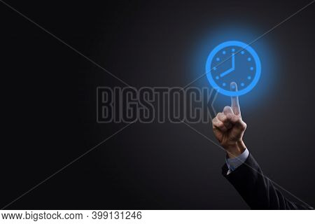 Businessman Hand Holds The Icon Of Hours Clock With Arrow. Rapid Execution Of The Work.business Time