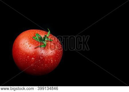 Tomato Isolated. Tomato With Drops On Black. Tomato Side View. Wet Tomato Black Background.
