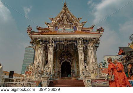 Bangkok, Thailand. Feb - 08, 2020 : Two Buddhist Monks Is Walking Into Main Vihan Buddhist Temple To