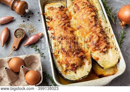 Baked Zucchini, Stuffed With Meat On The Gray Background
