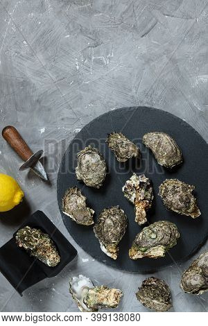 Oysters On A Round Slate Board