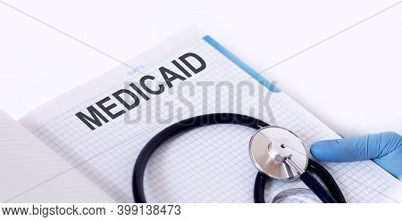 Medicaid .notepad With Text In Hand Of Medicine With Stethoscope