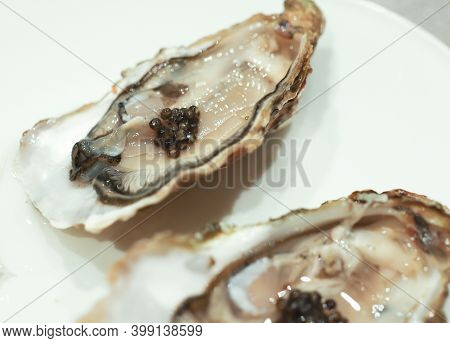 Black Sturgeon Caviar With Oysters On The White Plate